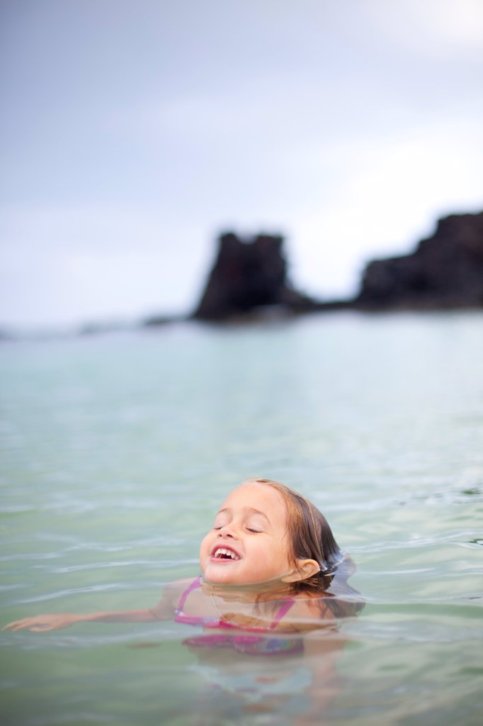 Young Girl in Water up to Chin : Stock Photo