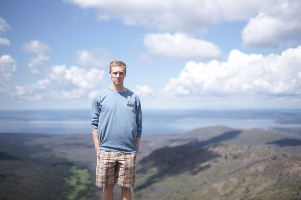 Stock Photo: 1838-14156 Young Man Portait Against Panoramic Landscape