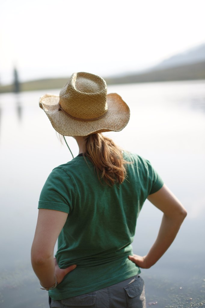 Young Woman in Hat Staring at Lake : Stock Photo