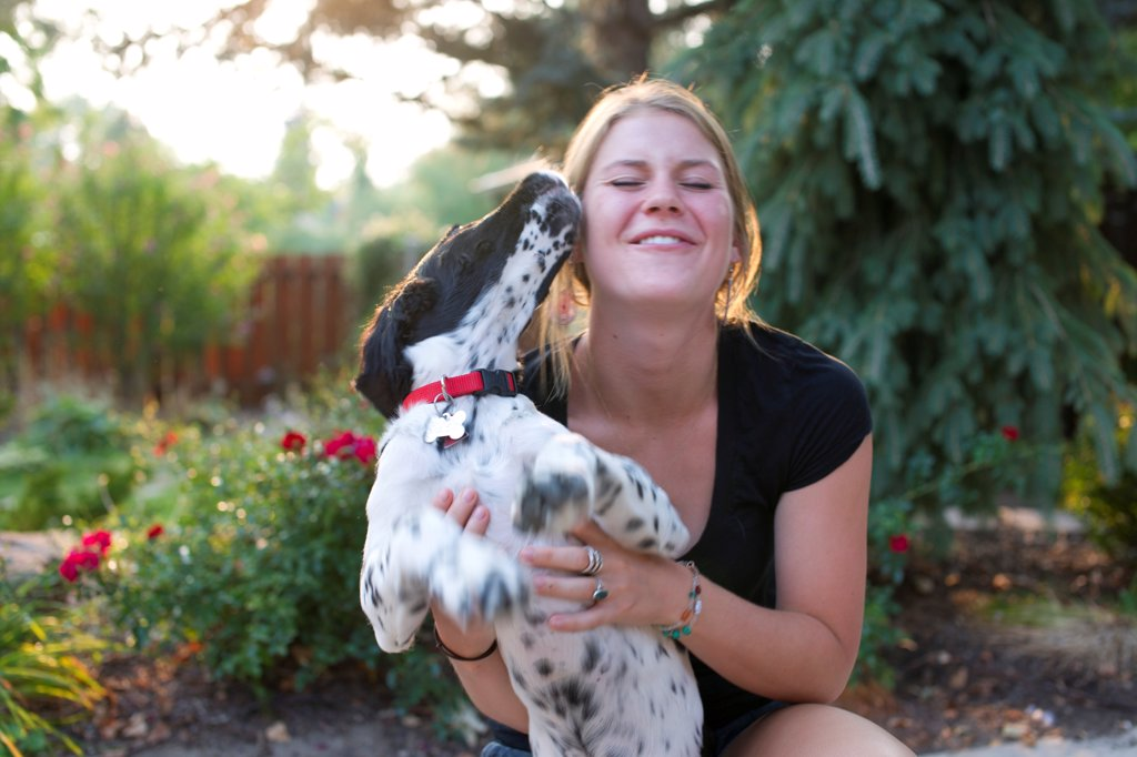 Young Woman Playing With Puppy : Stock Photo