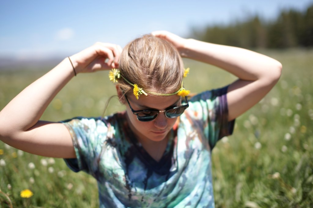 Stock Photo: 1838-14195 Young Woman Wearing Dandelion Headband