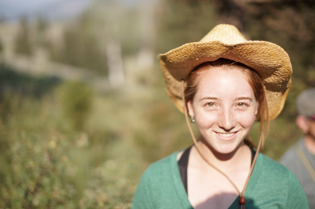 Stock Photo: 1838-14209 Smiling Young Woman Wearing Cowboy Hat, Portrait