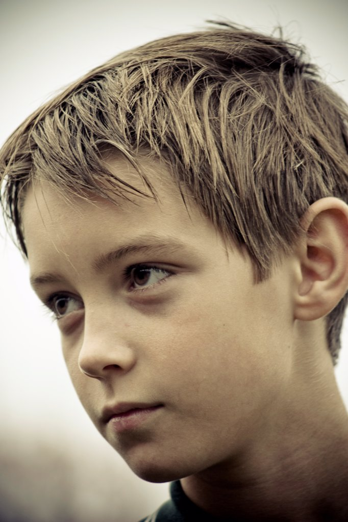 Stock Photo: 1838-14243 Serious Young Boy, Portrait