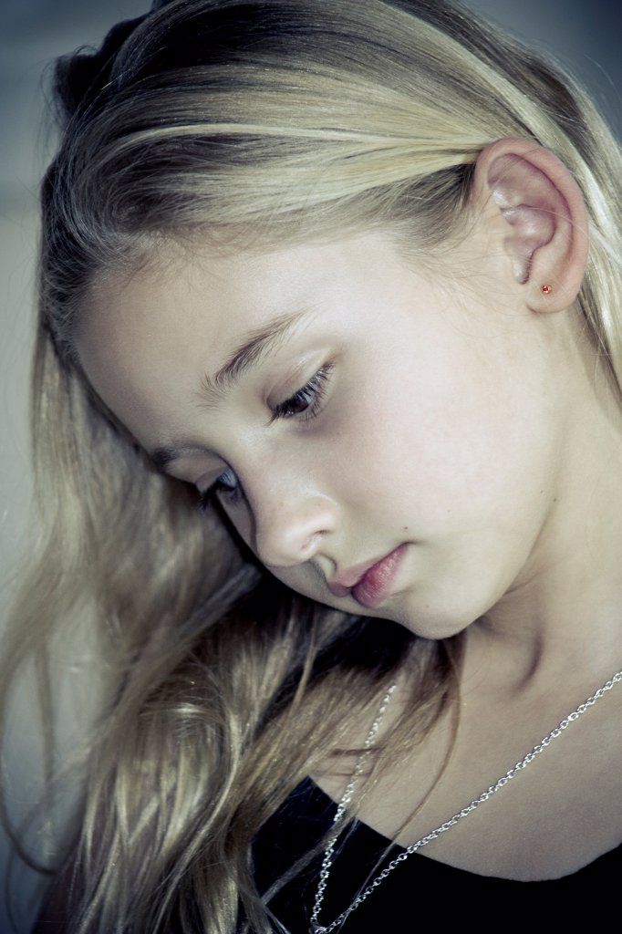 Stock Photo: 1838-14246 Young Blonde Girl Looking Down, Portrait