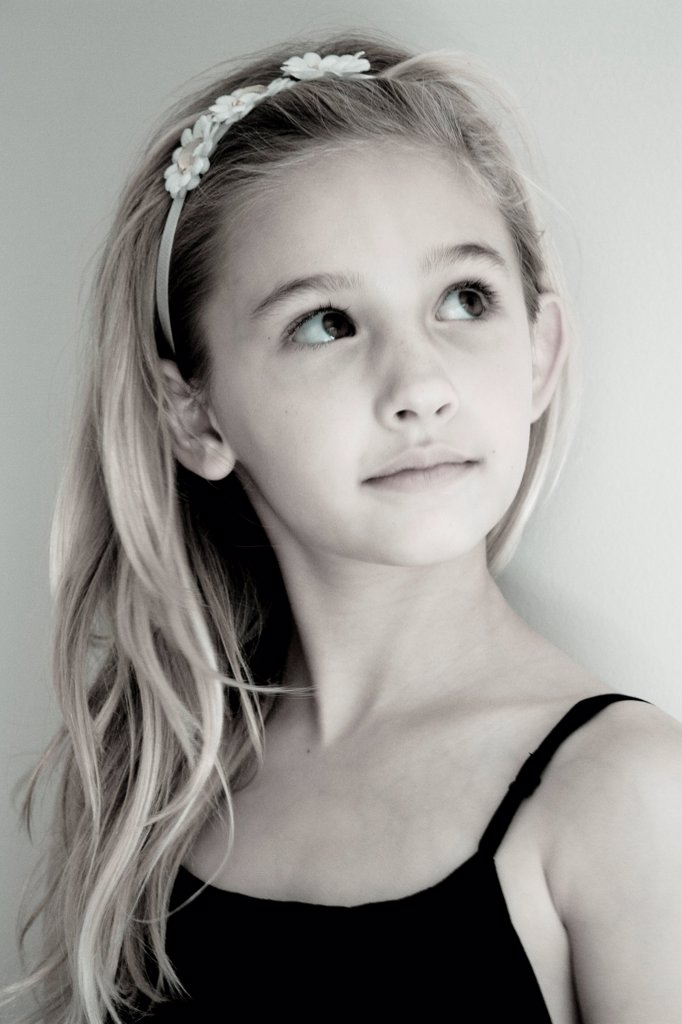 Stock Photo: 1838-14264 Young Girl With Blonde Hair Looking Up, Portrait
