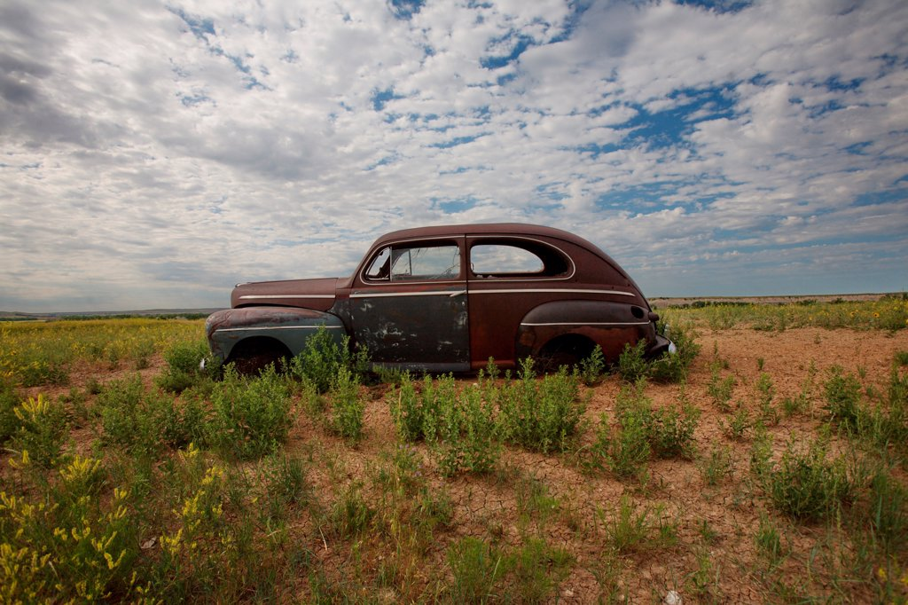 Old Abandonded Car in Field, Badlands National Park, South Dakota, USA : Stock Photo