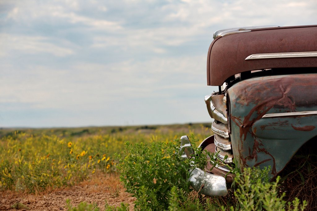 Stock Photo: 1838-14267 Old Abandonded Car in Field, Detail, Badlands National Park, South Dakota, USA