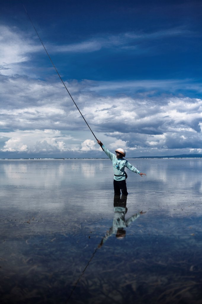 Stock Photo: 1838-14279 Man Fishing in Shallow Water, Bali, Indonesia