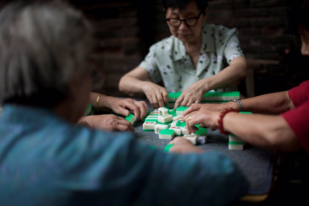 Stock Photo: 1838-14294 Small Group of Women Playing Mah Jong