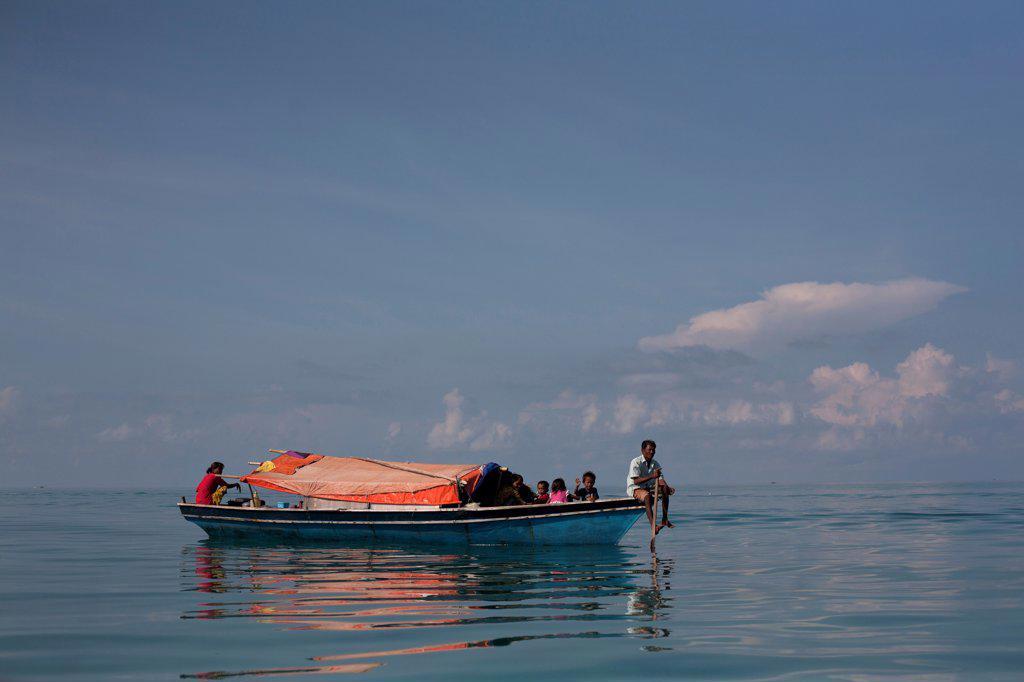 Stock Photo: 1838-14300 Bajau Laut or Sea Gypsies on Boat, Semporna, Borneo