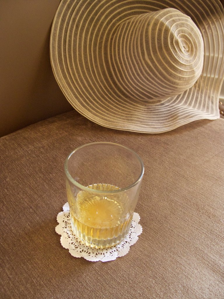 Stock Photo: 1838-14316 Glass of Bourban on Chair With Vintage Hat