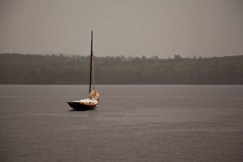 Stock Photo: 1838-14349 Sailboat Moored in Lake During Rain