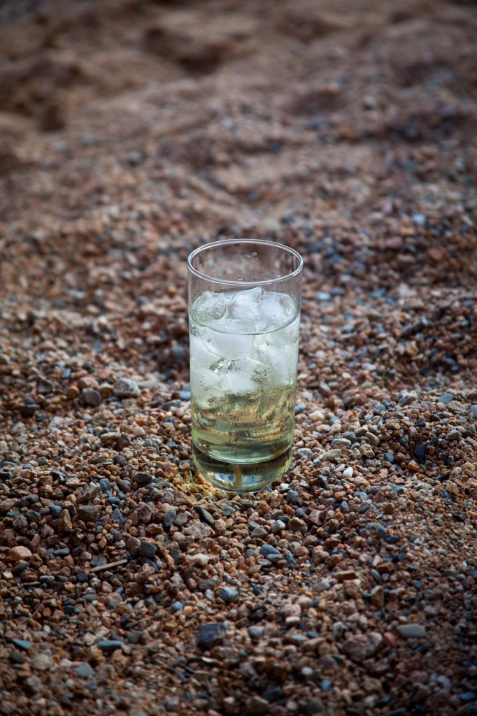 Stock Photo: 1838-14354 Cocktail in Glass With Ice on Beach