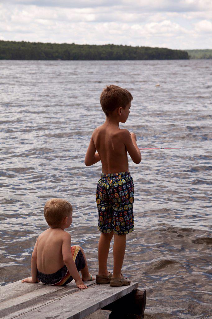 Stock Photo: 1838-14360 Two Boys Fishing on Dock
