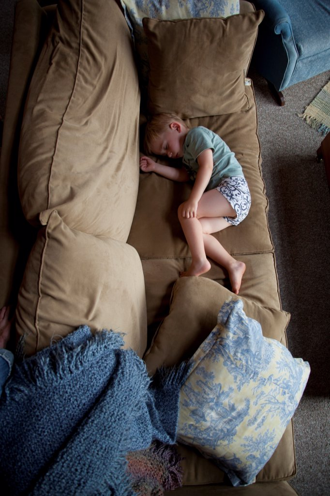 Stock Photo: 1838-14375 Young Boy Sleeping on Couch, High Angle View