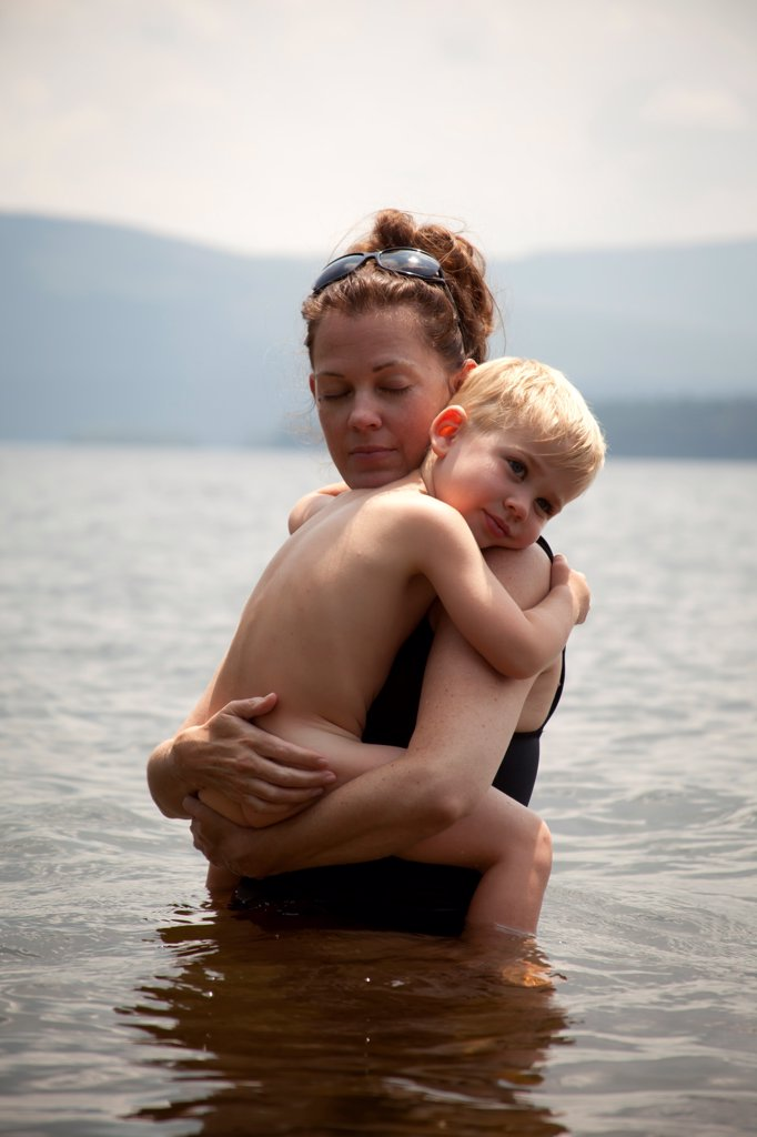 Stock Photo: 1838-14383 Mother Holding Son in Lake