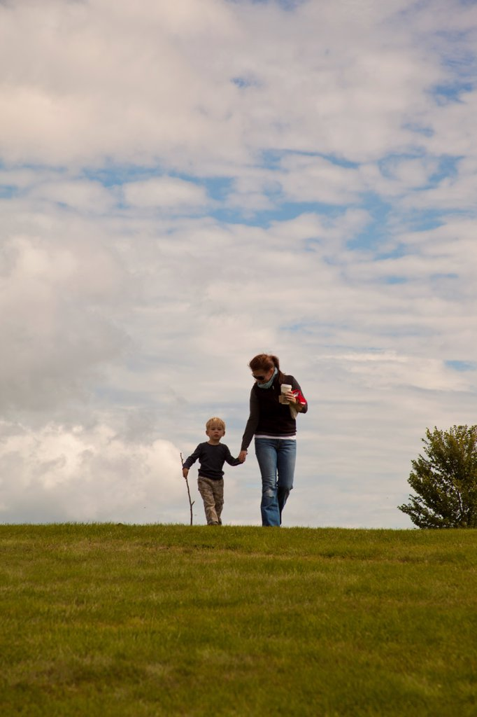 Mother and Son Walking Over Hill : Stock Photo