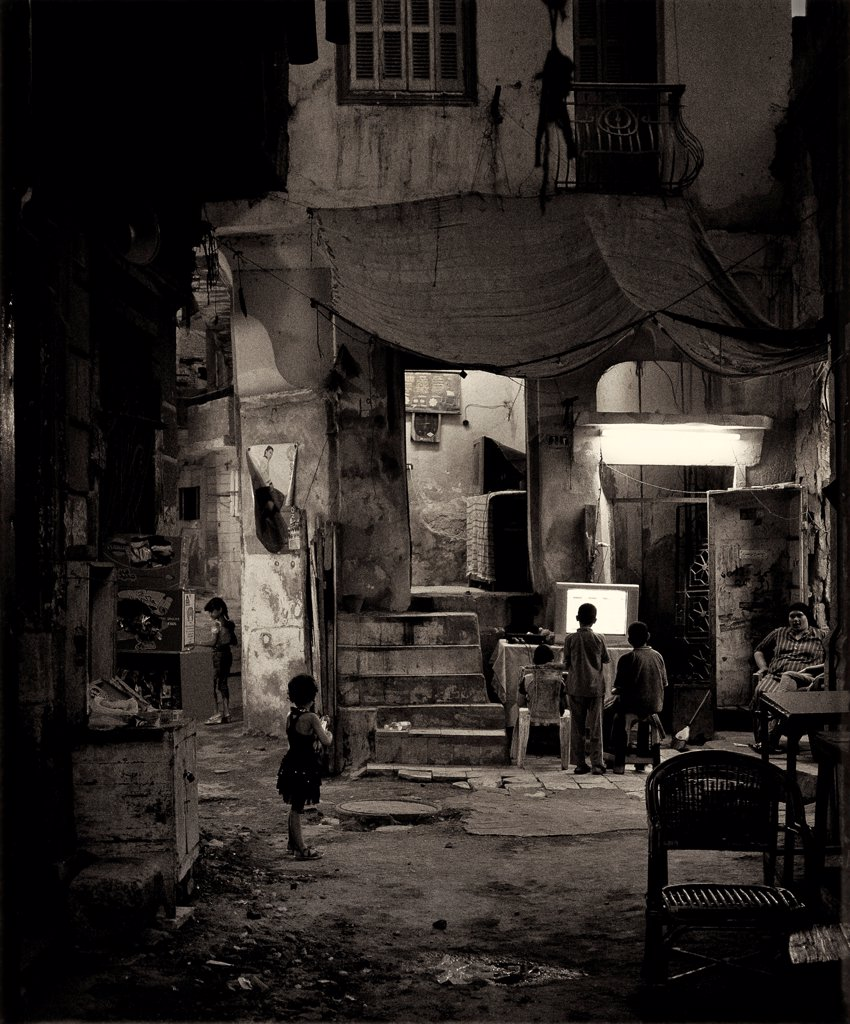 Stock Photo: 1838-14447 Children Watchin TV in Alley, Cairo, Egypt