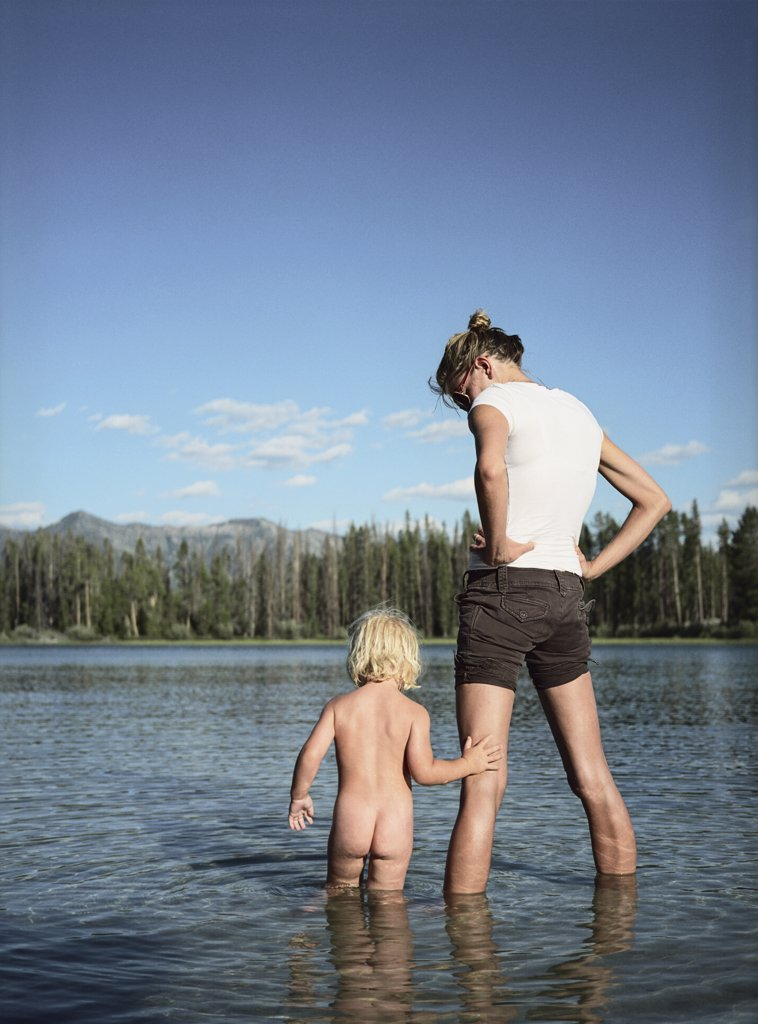 Stock Photo: 1838-1488 Mother and Toddler Standing in Lake
