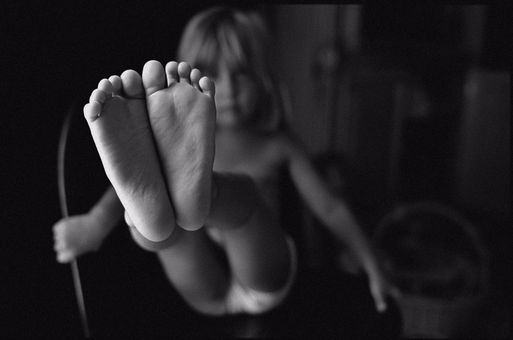 Stock Photo: 1838-1641 Little Girl Showing Her Feet