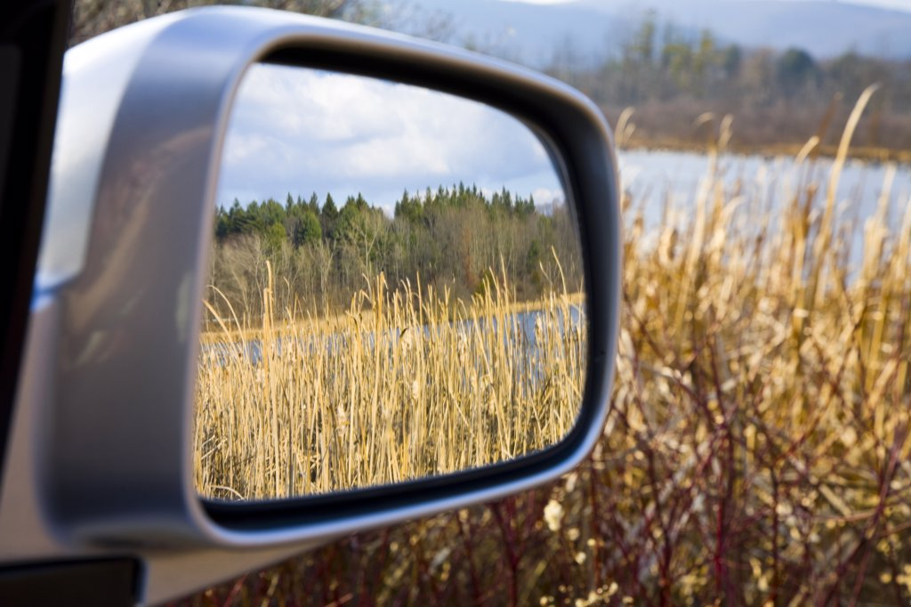 Nature Reflecting in Car Side View Mirror  : Stock Photo