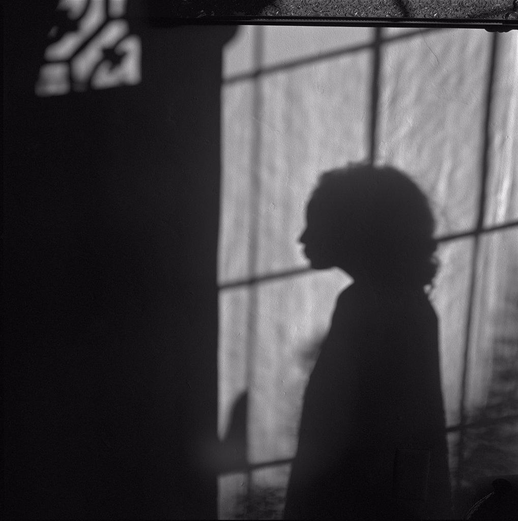 Girl's Shadow & Window : Stock Photo