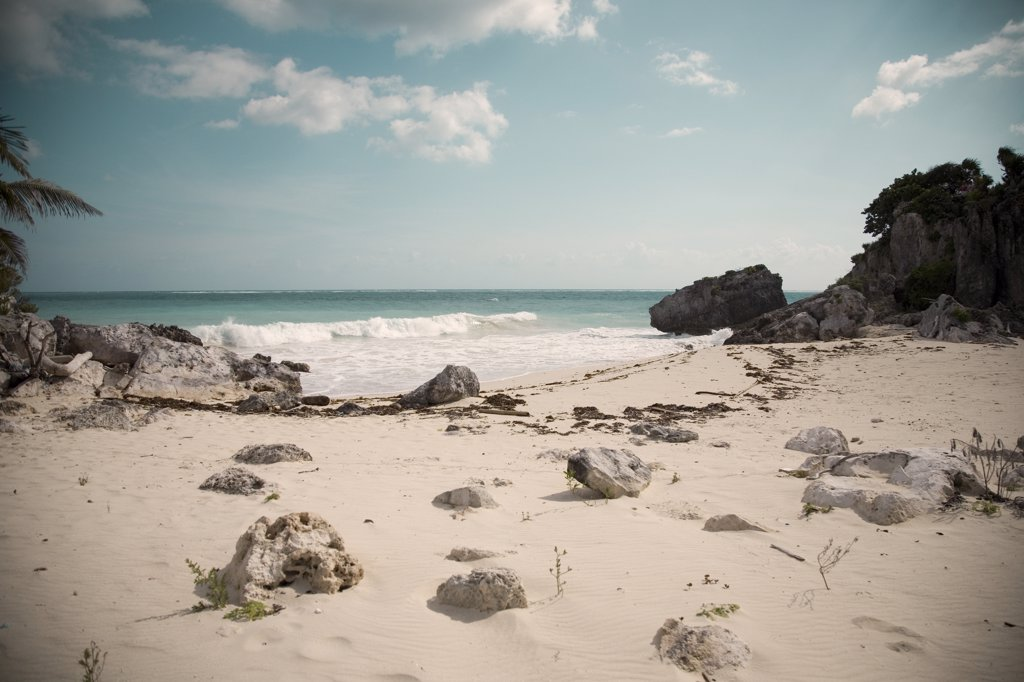 Sandy Beach with Rock Formations and crashing waves, Tulum, Mexico : Stock Photo