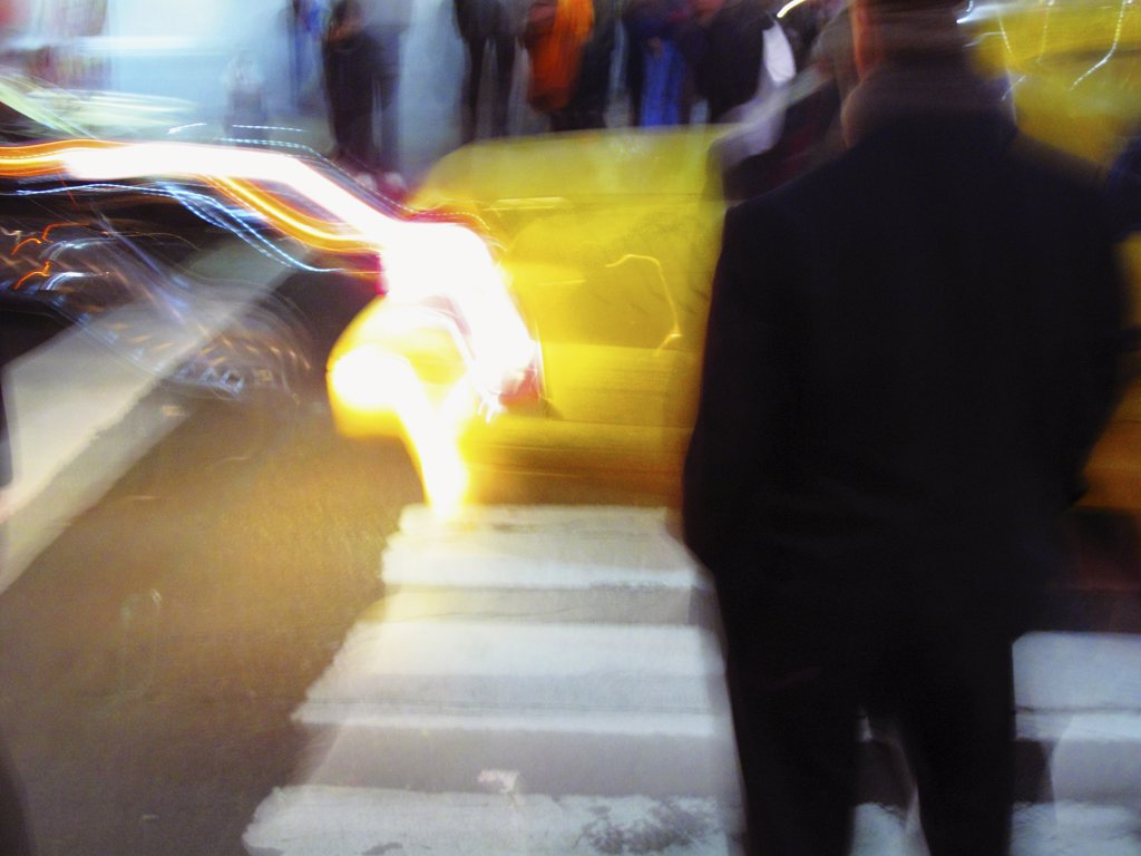 Stock Photo: 1838-8621 Blurred Street Scene With Taxi and Person Waiting to Cross Street, Manhattan, New York City, USA