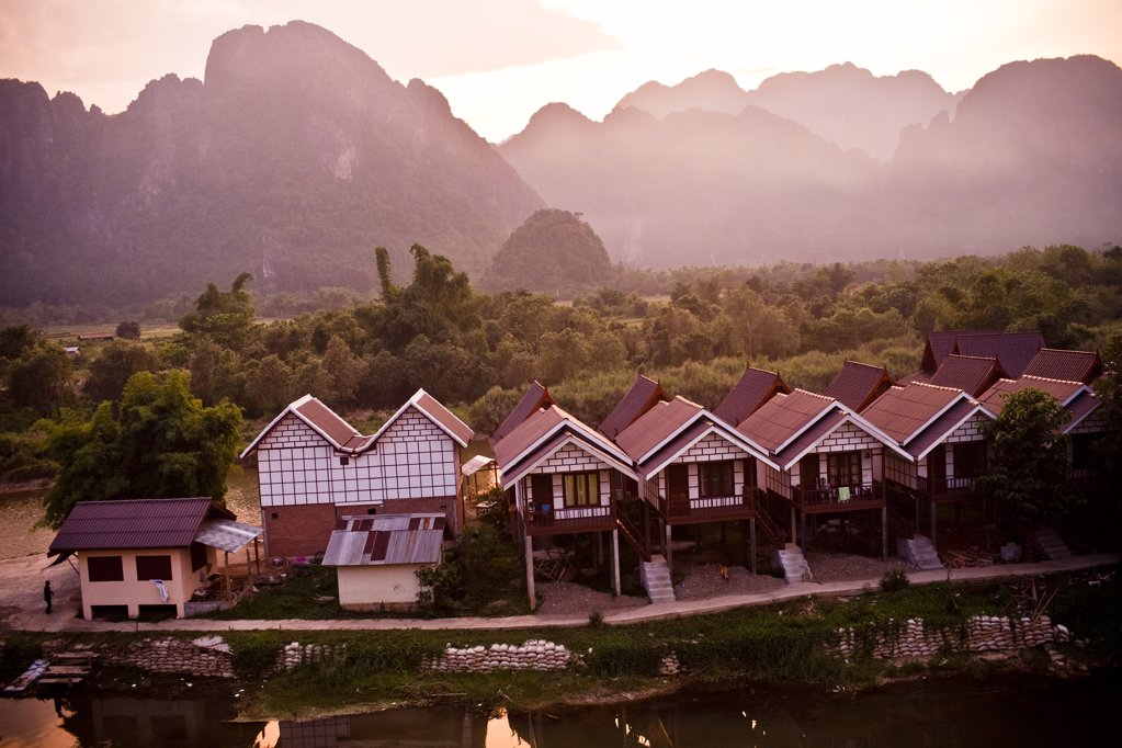 Stock Photo: 1838-9241 Small Cottages and Mountains at Sunset, Laos, Asia