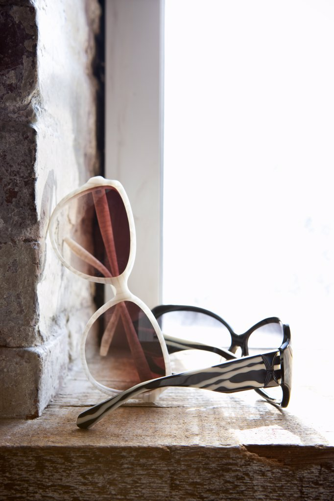 Sunglasses on Windowsill : Stock Photo