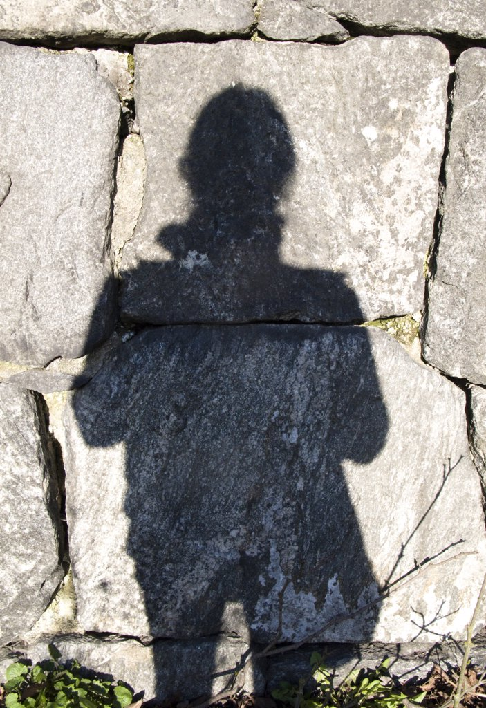 Human Shadow Against Rock Wall : Stock Photo