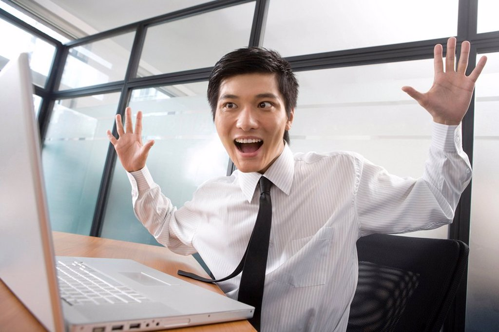 Stock Photo: 1839R-10050 Young businessman get surprised by laptop