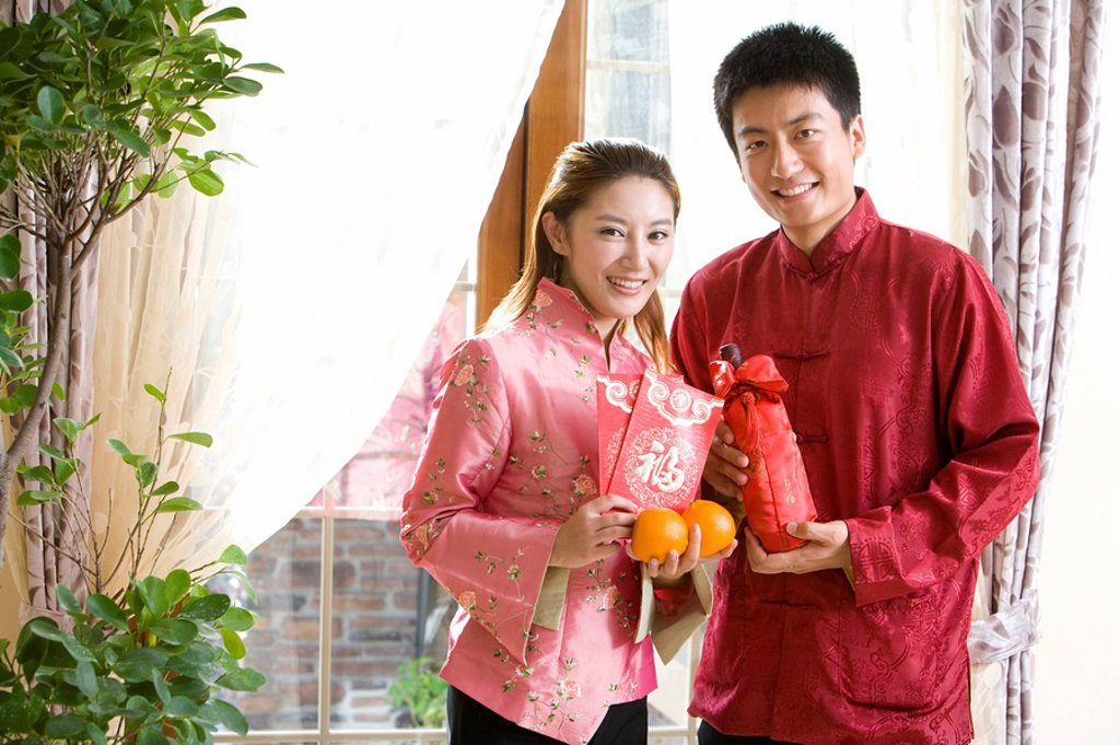 Portrait of young couple in Chinese New Year : Stock Photo