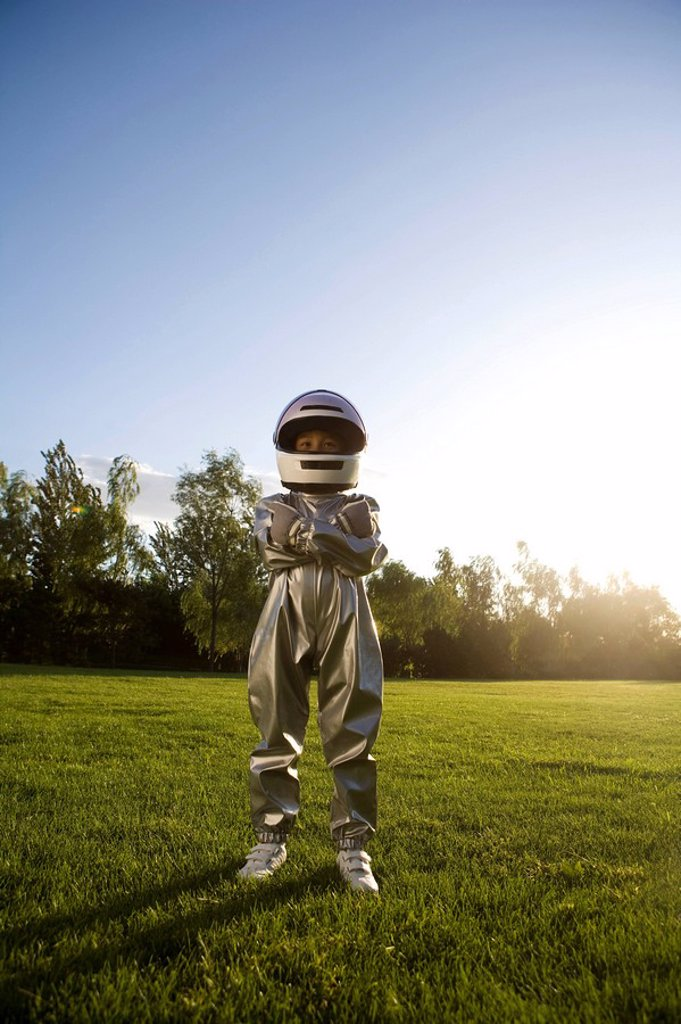 Stock Photo: 1839R-10688 Young boy playing astronaut