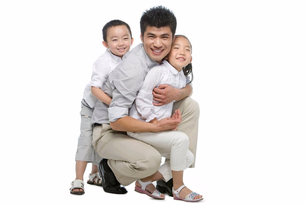 Portrait of father, son and daughter : Stock Photo