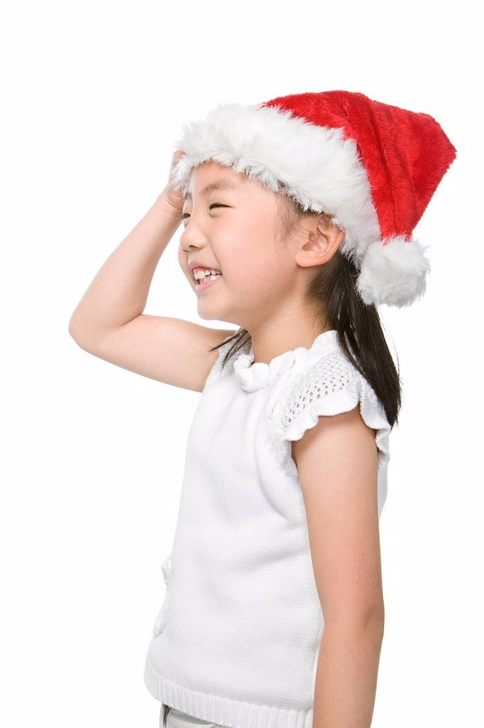 Portrait of girl with Santa hat : Stock Photo