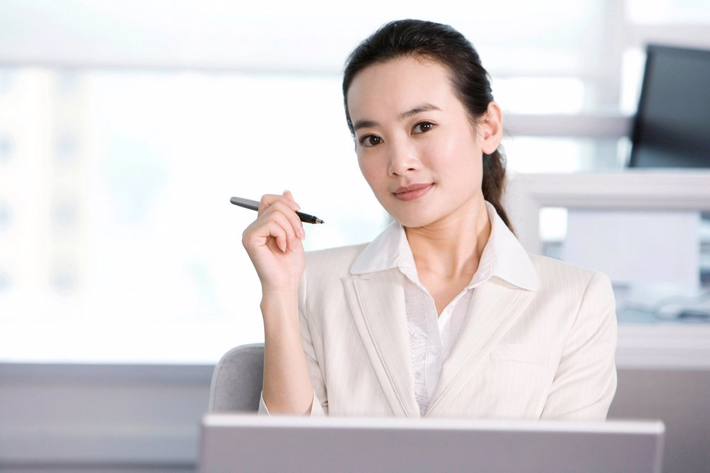 Office worker at her desk : Stock Photo