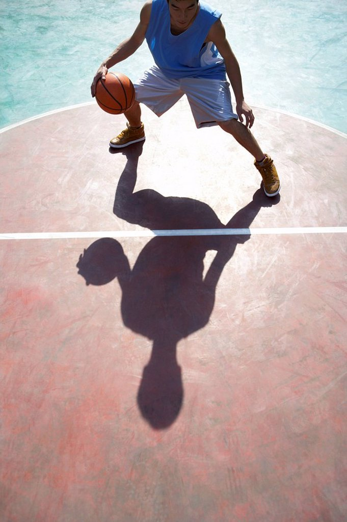 Young Man Playing Basketball : Stock Photo