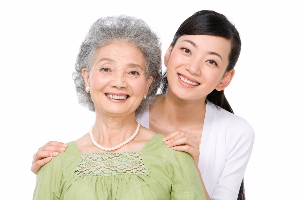 Portrait of mother and adult daughter : Stock Photo