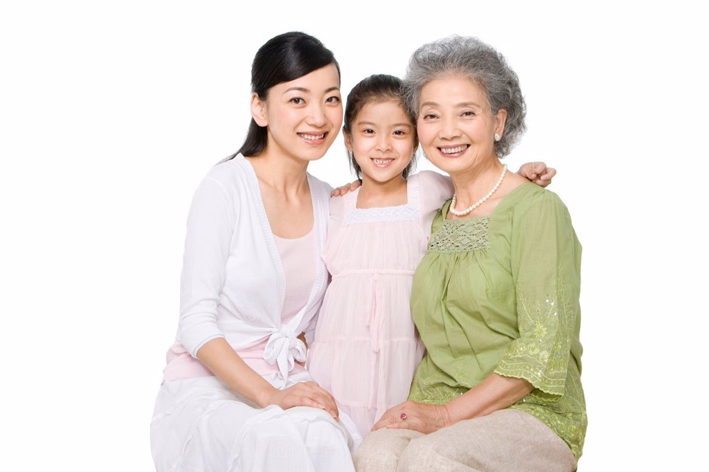 Portrait of three generations of ladies : Stock Photo