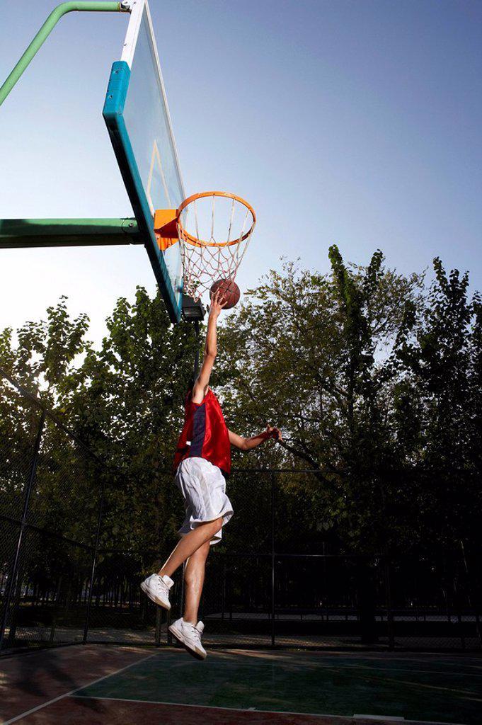 Basketball Player Shooting Hoops : Stock Photo