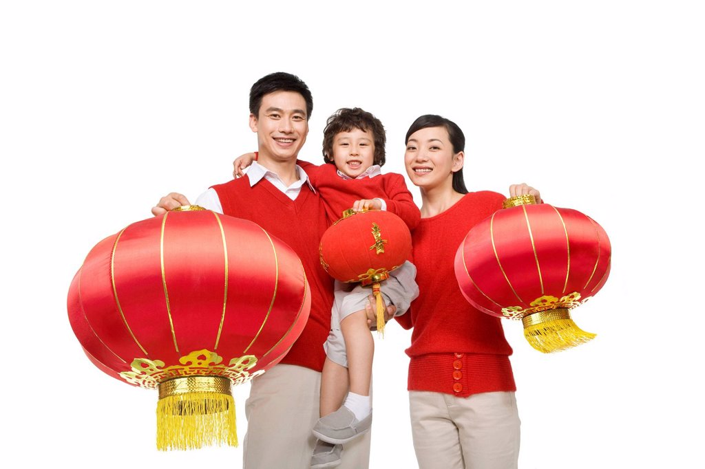 Stock Photo: 1839R-11521 Family celebrating Chinese New Years