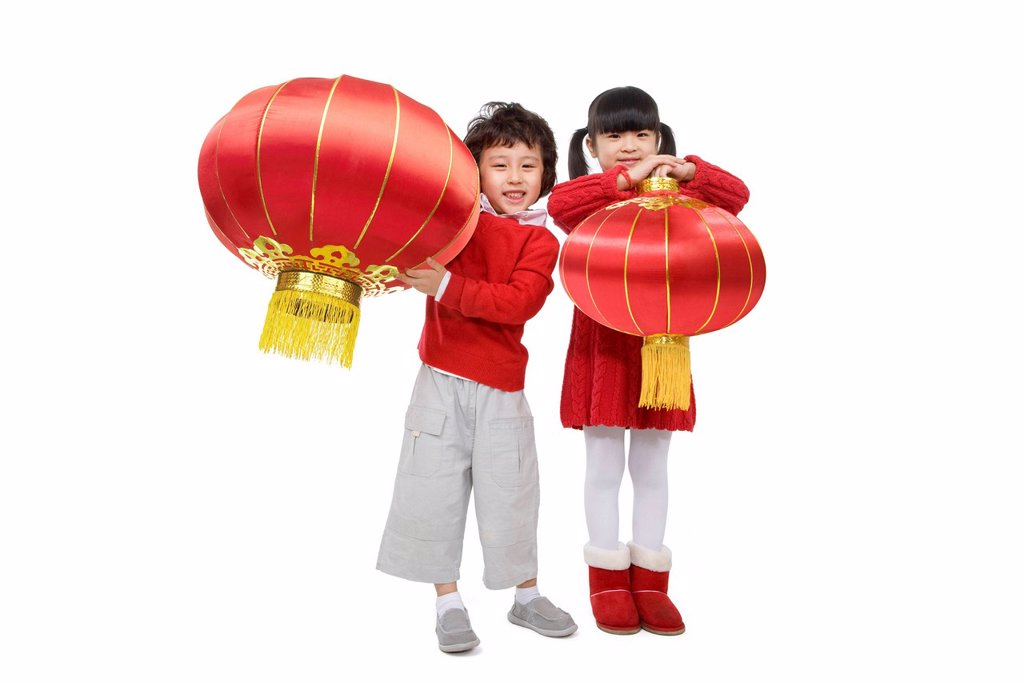 Stock Photo: 1839R-11527 Kids celebrating Chinese New Years