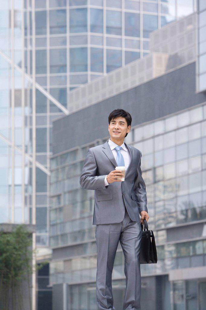 Stock Photo: 1839R-11962 Chinese businessman walking