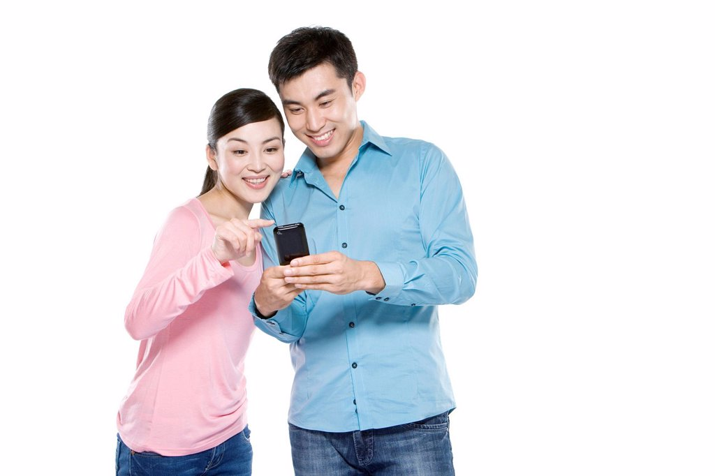 Couple Looking At Phone : Stock Photo