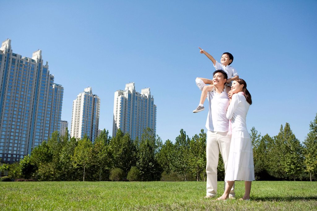 Young family enjoying the park : Stock Photo