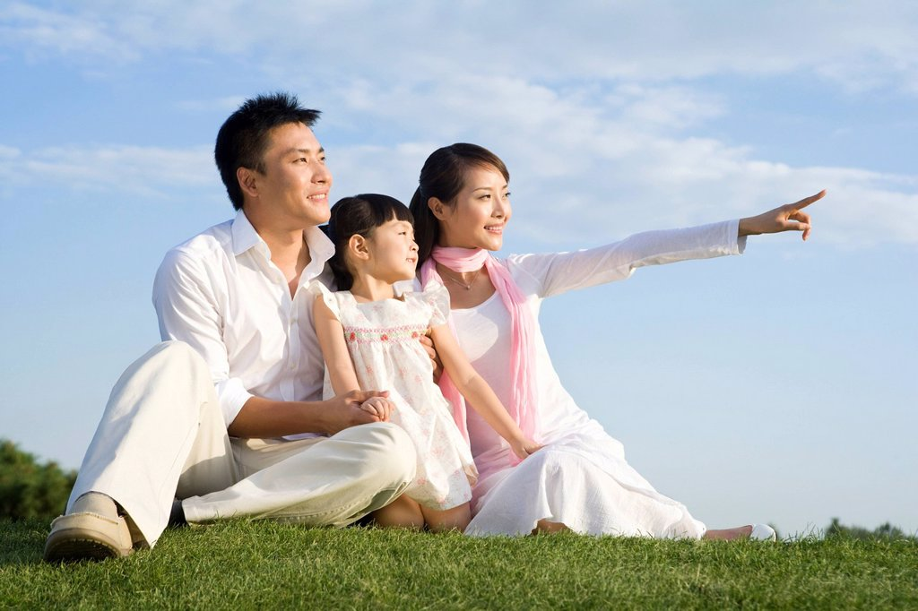 Stock Photo: 1839R-12399 A young family enjoying a beautiful day