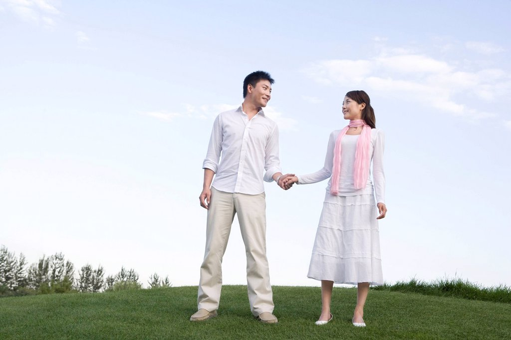 Young couple enjoying the park : Stock Photo