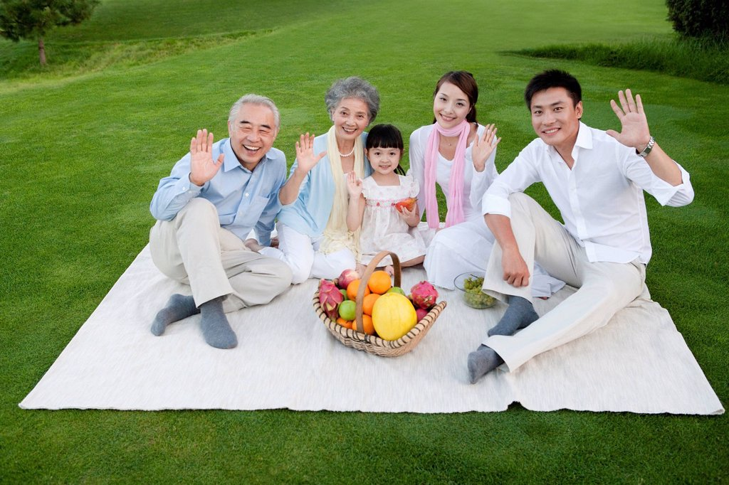 Stock Photo: 1839R-12437 A family gathered around for a picnic