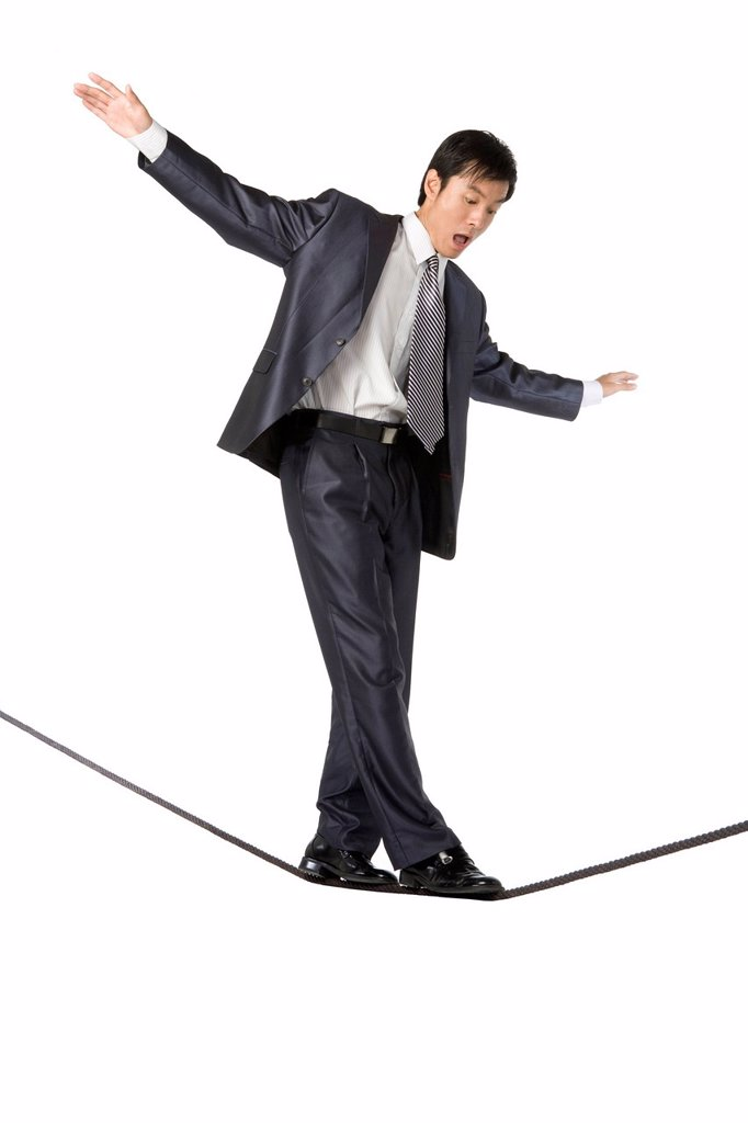 Businessman walking on rope in mid_air : Stock Photo